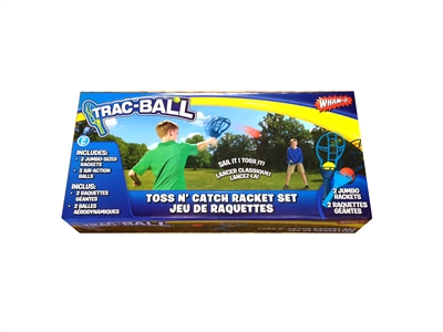 Wham-O Trac Ball package with two kids playing with the trac ball set. The kid in green is launching a trac ball towards the kid in blue. On package includes a picture of all contents in set. Two Trac Ball racquets & two trac balls.